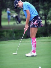 ShaeBug Scarberry, the defending champion of the Texas-Oklahoma Junior Golf Championship, watches her putt go in on Number 4 Monday morning at the Wichita Falls Country Club.