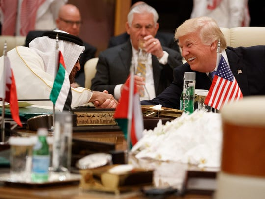 President Donald Trump shakes hands with Abu Dhabi's Crown Prince Mohammed bin Zayed Al Nahyan during a meeting with leaders at the Gulf Cooperation Council Summit, at the King Abdulaziz Conference Center on May 21, 2017, in Riyadh, Saudi Arabia.