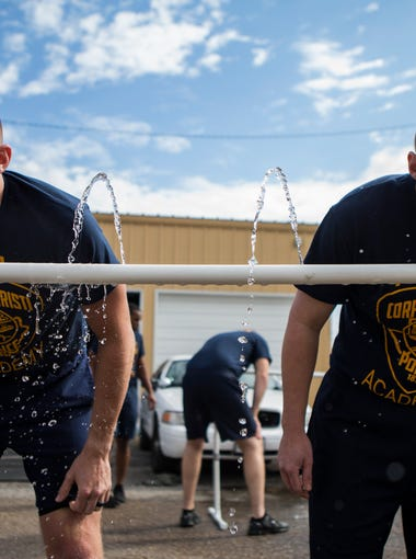Police cadets wash off their faces after being exposed to pepper spray on Friday, Dec. 5, 2017 at Corpus Christi Police Academy.