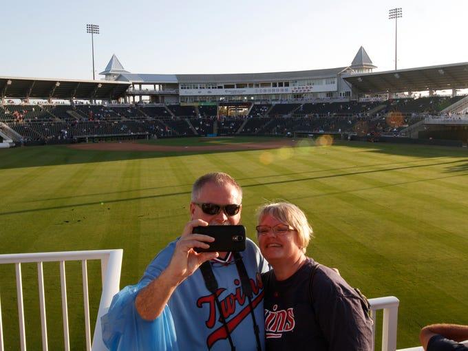 Minnesota Twins fans Jim and Justine Zeik take a souvenier