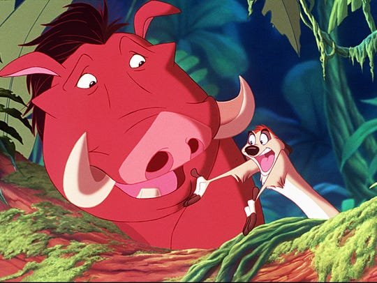 Pumbaa the warthog and his companion Timon the meerkat