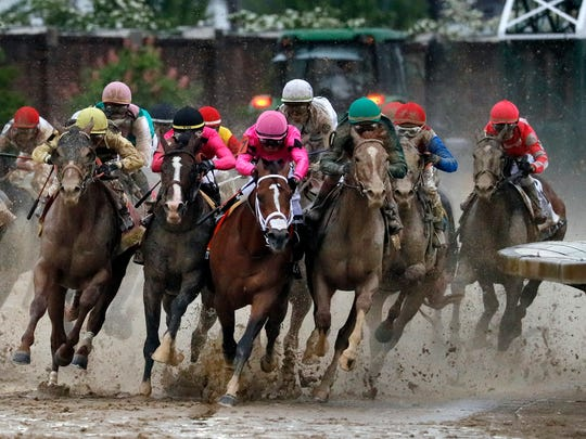 Country House, War of Will, Maximum Security and Code of Honor round the far turn during the 145th running of the Kentucky Derby on May 4 at Churchill Downs in Louisville, Ky.