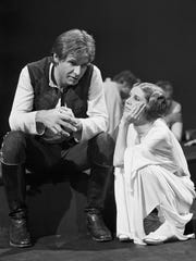 Harrison Ford talks with Carrie Fisher during a break