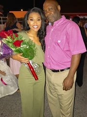 Miss Knoxville Brianna Mason and her father, Reggie, after she won her crown to qualify for Miss Tennessee.