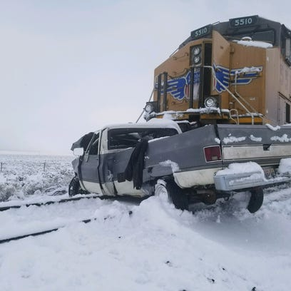The scene of a fatal crash between a pickup truck and