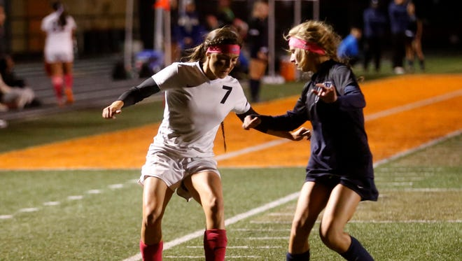 Aztec's Kinsey Gomez, left, keeps the ball away from Piedra Vista's Madison Cross on Tuesday at Fred Cook Memorial Stadium in Aztec.