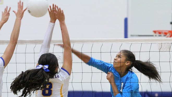 Navajo Prep's Martinique Larvingo delivers a kill during a match against Bloomfield on Thursday at Bobcat Gym in Bloomfield.