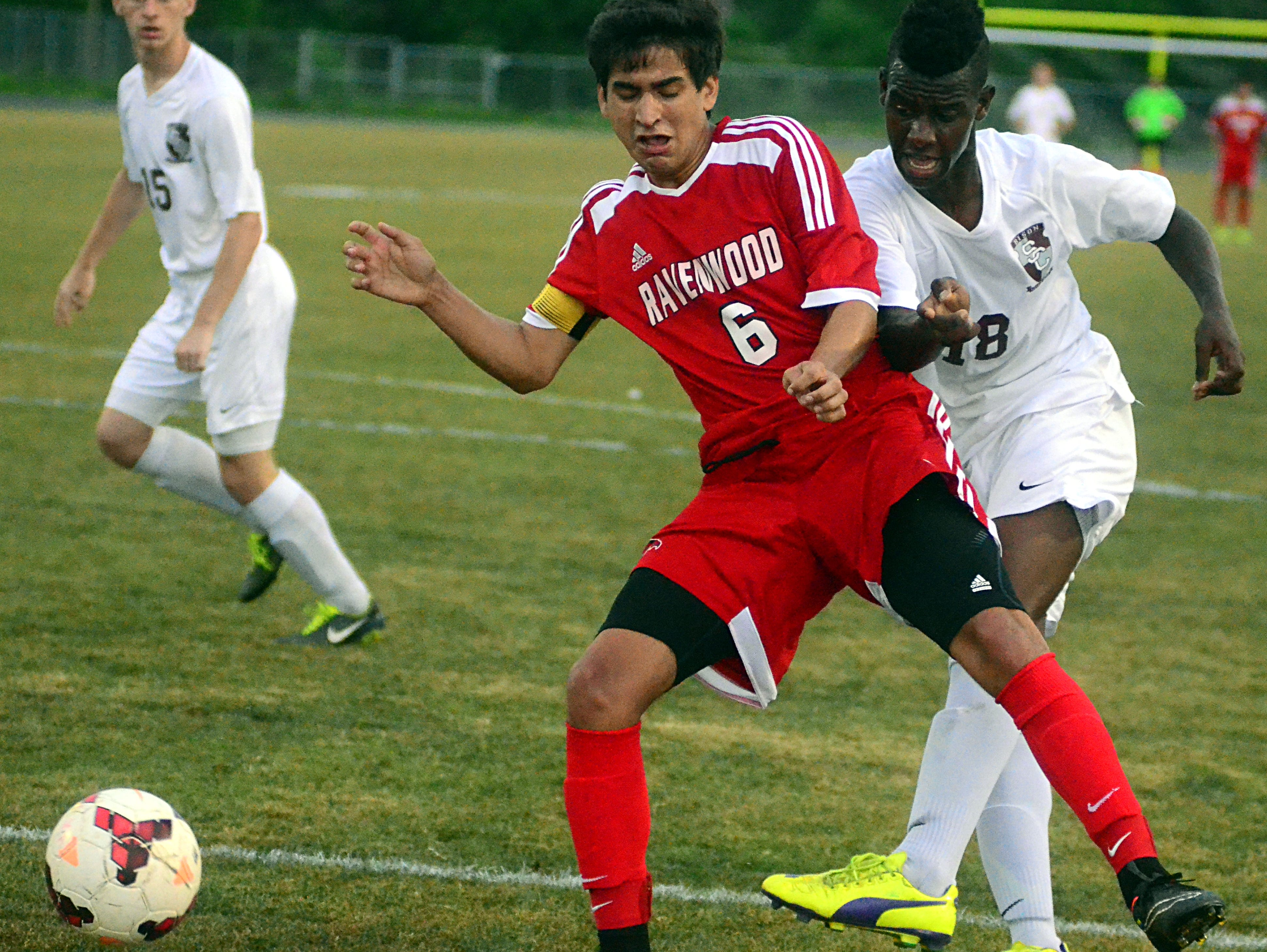 Ravenwood defender Pedro Cobo battles with Station Camp's Atakelti Gebrezgabher for a loose ball during Saturday's AAA sectional. The Raptors will be competing in this week's state tournament in Murfreesboro.