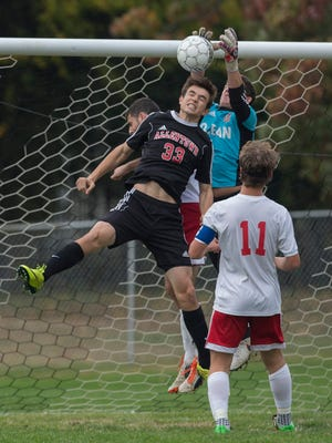 Ocean goalie Max Winters pulls in a shot on goal before Allentown's Sam Togna can get his head on it. Allentown vs Ocean Twp Boys Soccer in State Playoff game in Ocean Township, NJ on November 3, 2016