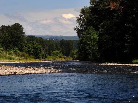 The Santiam River flows as seen from the Stayton Bridge County Boat Ramp, on Monday, June 22, 2015, Stayton, Ore. Afternoon fishing will be closed down on many Oregon rivers beginning Saturday, and will be closed entirely on some streams due to the ongoing drought and high water temperatures.