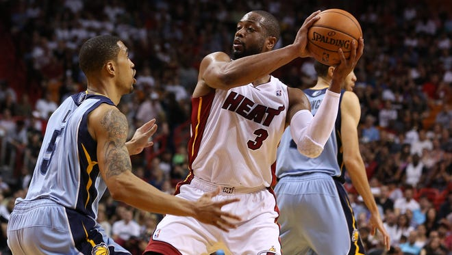 Miami Heat guard Dwyane Wade (3) looks to pass the ball as Memphis Grizzlies guard Courtney Lee (5) defends.