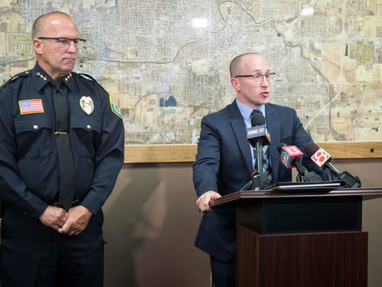 Chief Deputy Prosecutor Zach Craig and Muncie Police Chief Joe Winkle take questions at a news conference at City Hall following a series of drug-related arrests in September 2017.