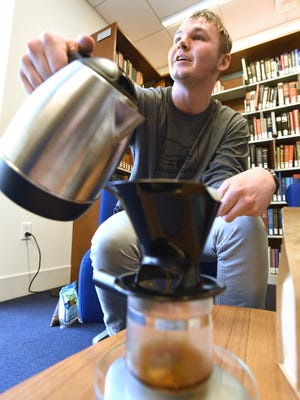 Daniel Jennings of Jennings' Java pours a cup of freshly ground coffee while talking about his business at Muskingum University recently. Jennings orders fresh beans and then roasts and grounds his own coffee. His coffee can be ordered through jenningsjava.com.