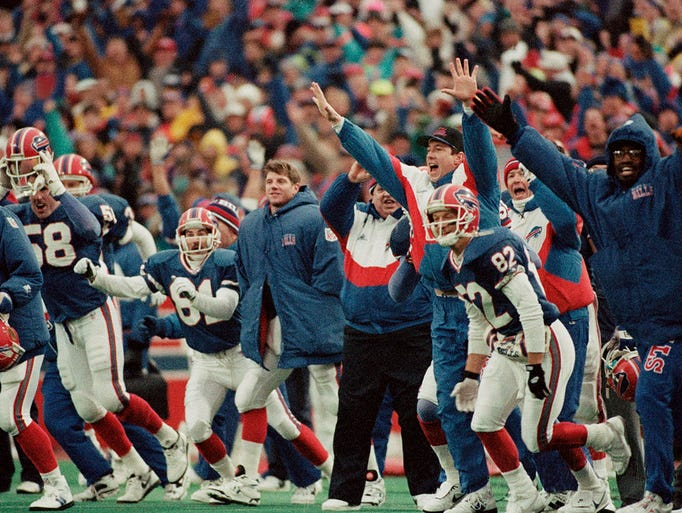The Buffalo Bills bench, including receiver Don Beebe