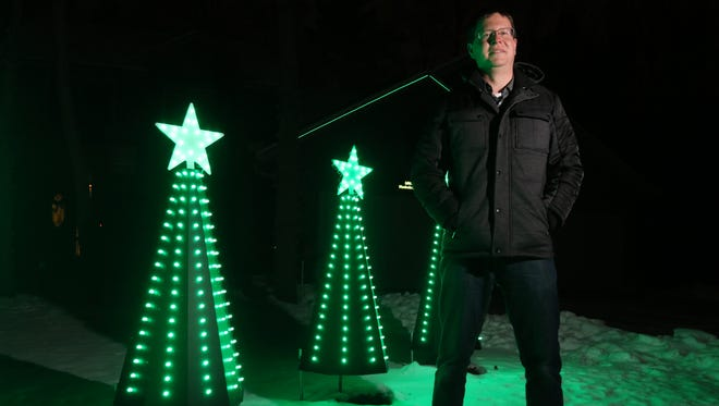 Andrew Konkol of Wisconsin Rapids begins the detailed process of creating a musically timed Christmas light show each year in August. He gets a crowd of eight or more cars each night in front of his family's home at 2730 31st St. S. to view the show.