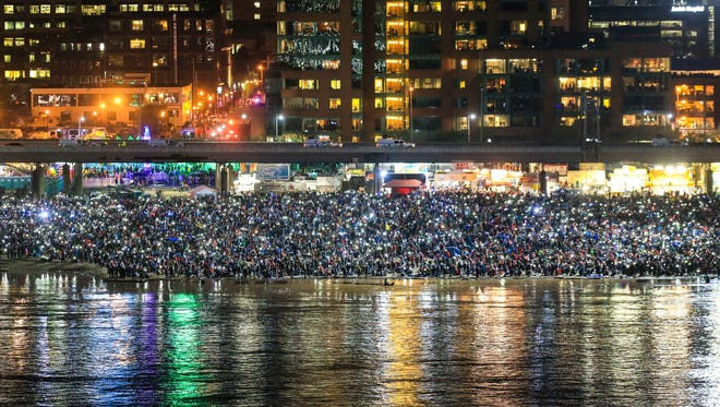 Thousands of people used phones and glow sticks to light up Louisville's Great Lawn before the start of the fireworks at  Thunder Over Louisville. Saturday. April 21, 2018