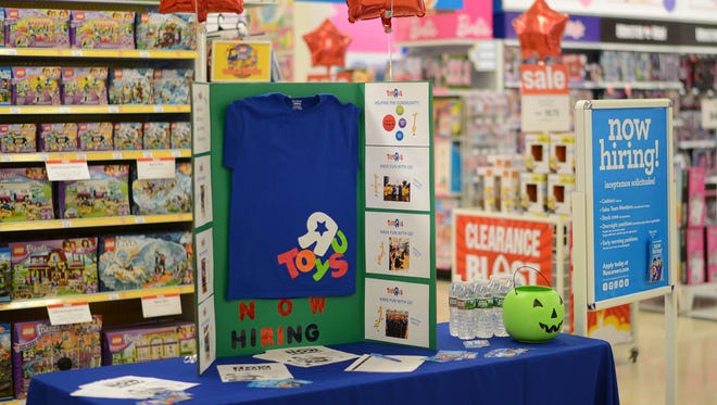 A holiday jobs recruitment table in October 2016 at the Toys R Us in Totowa, N.J. Despite its bankruptcy filing, the retailer issued its annual call for holiday workers Thursday, Sept. 21, 2017.