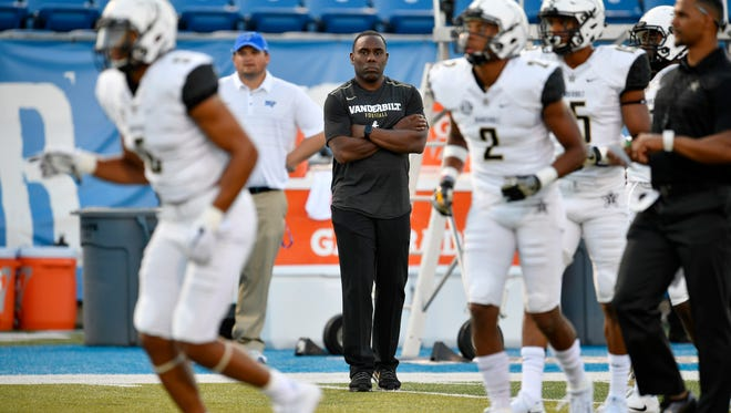"Vanderbilt head coach Derek Mason watches his players warm up before the start of an NCAA college football game against MTSU at Johnny ""Red"" Floyd Stadium in Murfreesboro, Tenn., Saturday, Sept. 2, 2017."