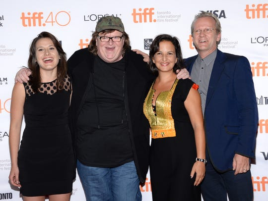 Director Michael Moore (second from left) with those