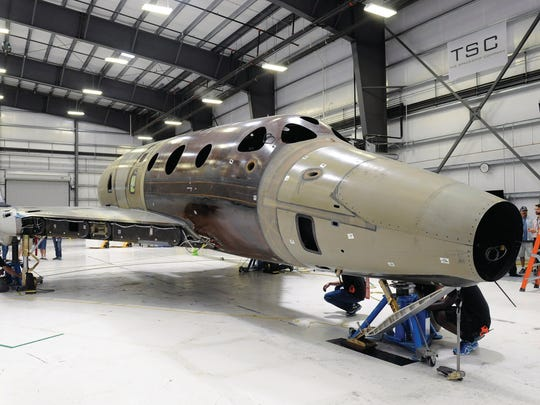 Virgin Galactic's second SpaceShipTwo is lowered on