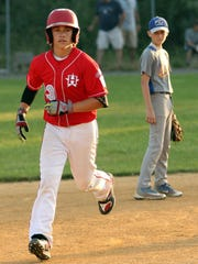Holbrook's Christopher Cartnick rounds the bases after