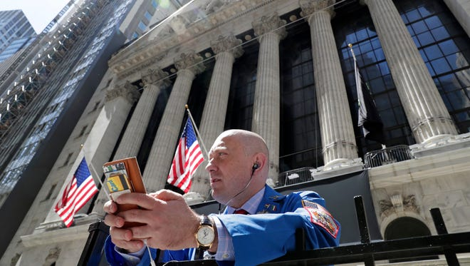 Vincent Pepe stands outside the New York Stock Exchange where he works in the Financial District in New York. The U.S. stock market opens at 9:30 a.m. EDT on Friday, June 15.