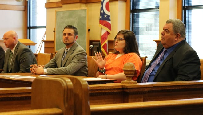 Jordyn Beckhusen, center, was sentenced to to 4 ½ years in prison. She is joined by her attorneys, Patrick Mancinetti, left, and Tom DeBacco, right, in Ottawa Common Pleas Court.