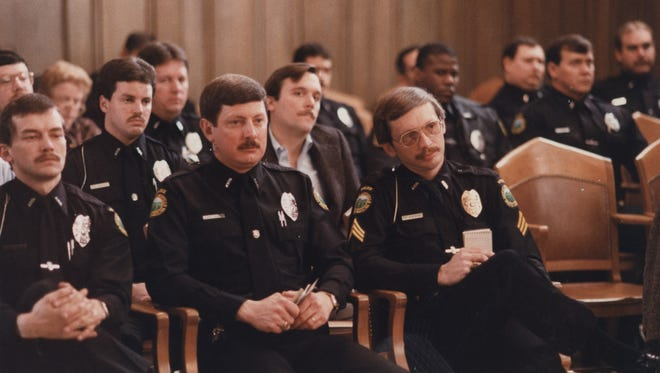 Officers at a City Council meeting.