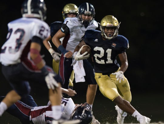 St. James' Tony Amerson (21) runs downfield during