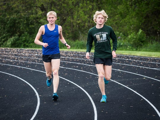 Wapahani's Alex and Nathan Herbst run on the track