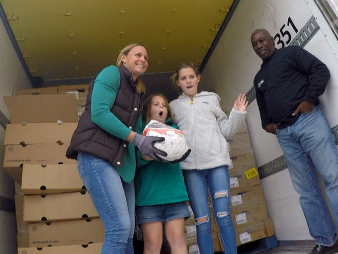 Soccer star Christie Pearce Rampone and her daughters