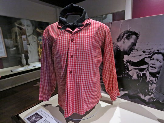 """This shirt was worn by John Wayne in the role as Ethan Edwards in the Warner Brothers 1956 movie, """"The Searchers,"""" and it is seen in The Reel West exhibit at the Eiteljorg Museum, Thursday, March 1, 2018.  The exhibit, which runs Mar. 3, 2018 to Feb. 3, 2019, looks at """"morality, diversity, and American identity,"""" seen through the Western film genre, Hollywood movies, and television shows."""