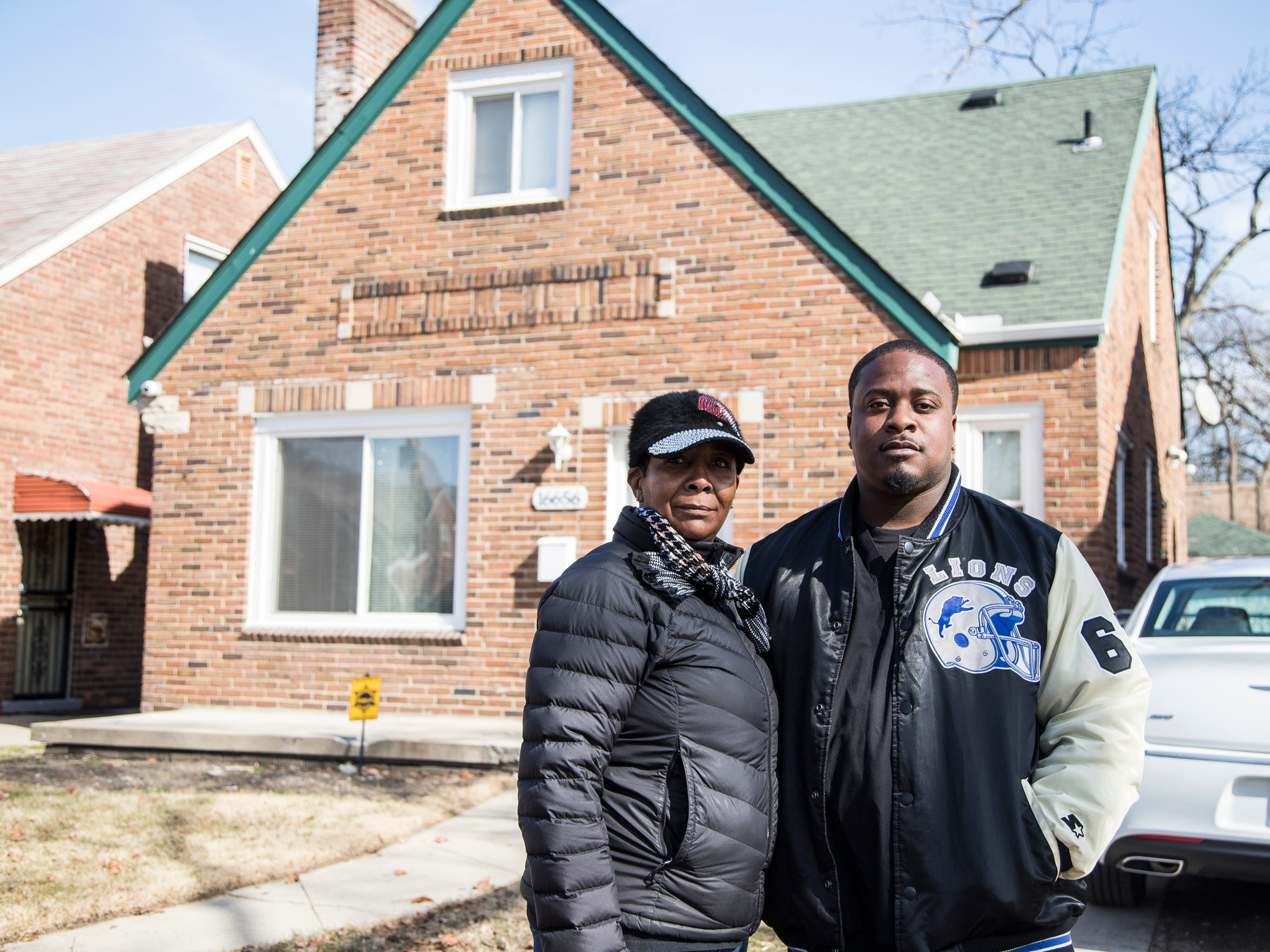 Denise Sailes and her husband, Ricky Sailes, in front of their house on Robson Street in Detroit on Tuesday, Feb. 27, 2018.