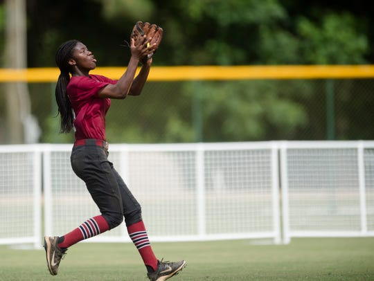 Prattville's Ty Wilson catches a fly ball during the