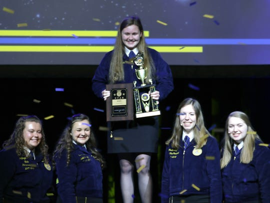 Danielle Wrzesinski, a Big Foot FFA member, accepts the Wisconsin Star in Agriscience award during the Wisconsin State FFA Convention on June 13 in Madison.