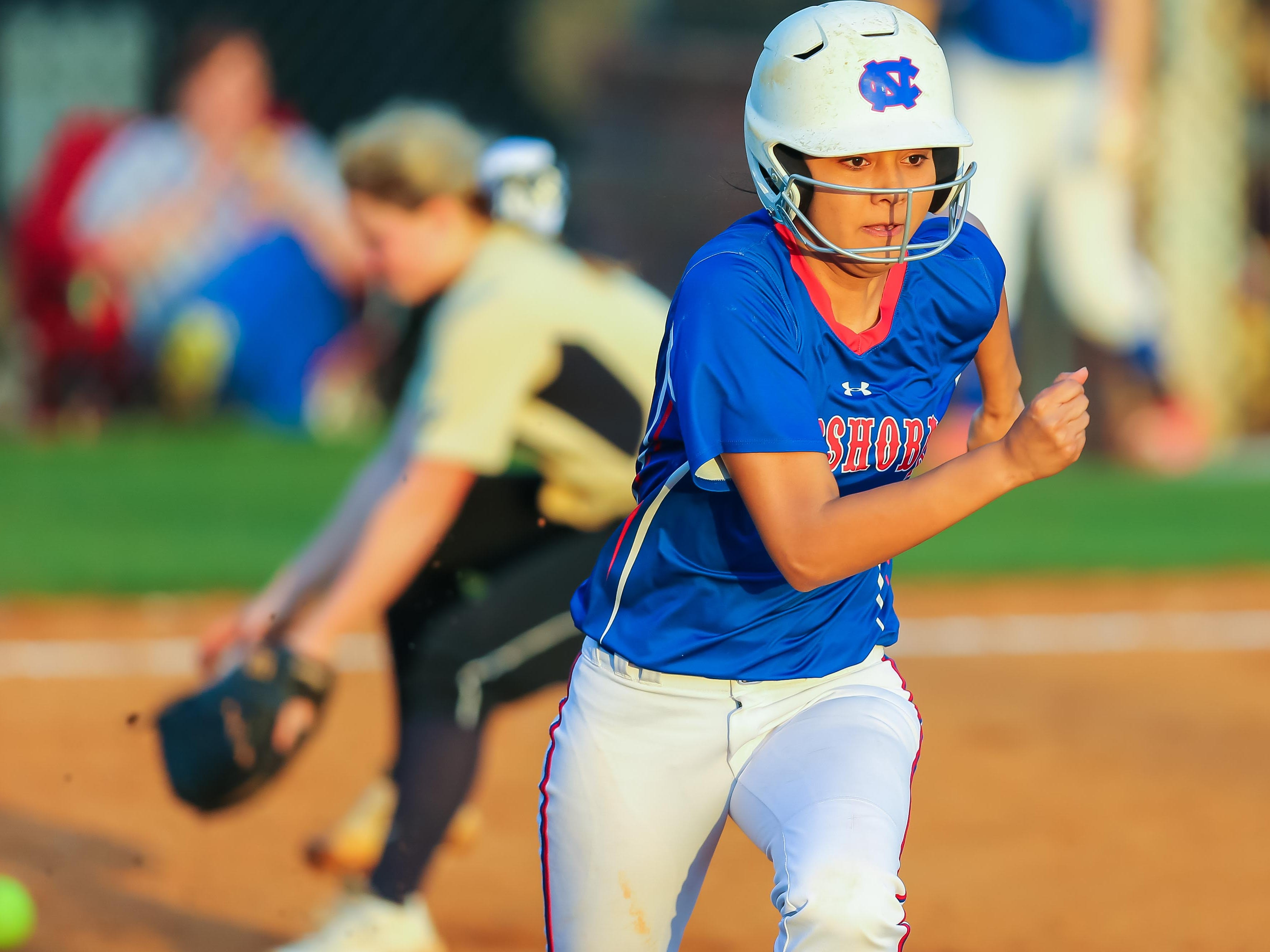 Neshoba Central shortstop Hailey Lunderman beats out a bunt as Neshoba Central beat Northwest Rankin, 6-5.
