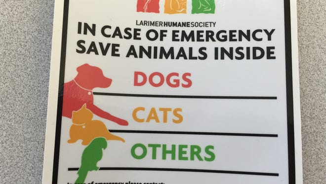 Larimer Humane Society will provide stickers that allow homeowners to say how many dogs, cats and other animals live in the home. Danielle Hastings, spokeswoman for Larimer Humane Society, said the stickers let first responders know exactly how many animals are in a home.
