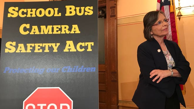 Assemblywoman Donna Lupardo, D-Endwell, Broome County, listens at a news conference Tuesday, June 12, 2018, at the state Capitol on a measure to add cameras on school buses to catch drivers illegally passing them.