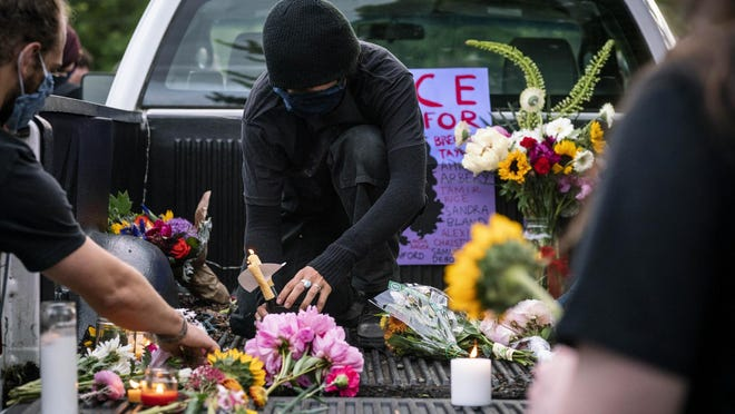 The BIPOC Liberation Coalition organized a silent, candlelit vigil in honor of those who have died at the hands of police violence and systemic racism. [Dana Sparks/The Register-Guard] - registerguard.com