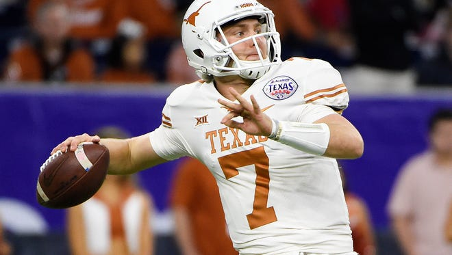 Texas quarterback Shane Buechele gets ready to throw a pass during the first half of the Texas Bowl NCAA college football game against Missouri, Wednesday, Dec. 27, 2017, in Houston.