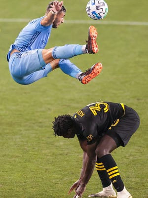 New York City FC midfielder Valentin Castellanos falls to the ground after battling Columbus Crew defender Aboubacar Keita (30) for a high ball during the second half at Red Bull Arena in Harrison, N.J., on Monday night, Aug 24, 2020.