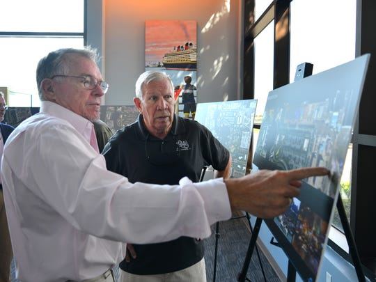 Randy Hollingworth of Bermello Ajamil & Partners discusses plan for Port Canaveral's Cove area with Rusty Fischer, owner of Rusty's Seafood & Oyster Bar at Port Canaveral.