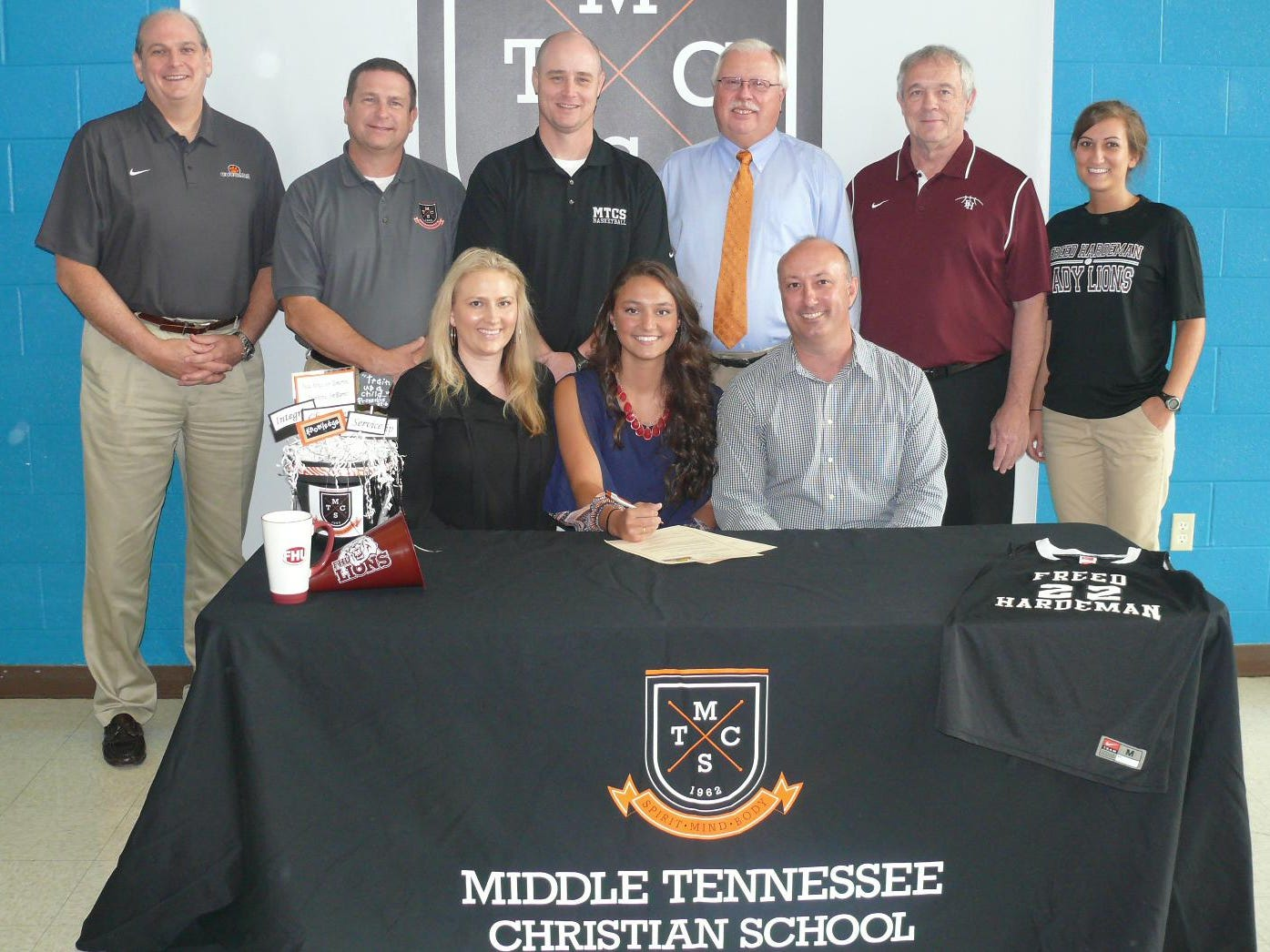 MTCS senior Ashlynd Wilkerson signed with Freed-Hardeman. In the front, from left, are mom Callan Wilkerson, Ashlynd Wilkerson and dad Brad Wilkerson. In the back, from left, is MTCS President Phil Ellenburg, MTCS Principal Todd Miller, MTCS Athletic Director Jason Piercey, MTCS girls basketball coach Lynn Burkey, Freed-Hardeman women's coach Dale Neal and Freed-Hardeman assistant Alissa Hargett.