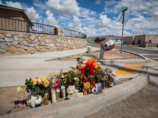 "A shrine to 6-year-old Sebastian ""Angel"" Fragoso Jr., who was killed Thursday by a hit-and-run driver in Anthony, N.M., sits Monday, August 29, 2016, at the intersection of Fourth Street and Putter Circle, the site of the crash."