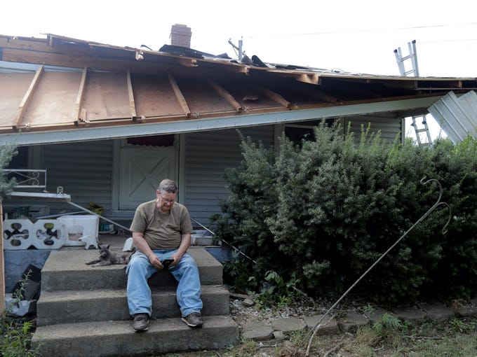 "Richard Bauman and ""cat"" were home when the tornado"