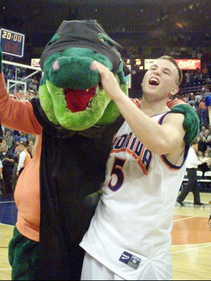 Florida's Teddy Dupay, right, celebrates Florida's 75-68 win over Kentucky with Florida mascot, Albert the Alligator, Thursday, Feb. 4, 1999, at the Stephen C. O'Connell Center in Gainesville, Fla. (AP Photo/The Gainesville Sun, Alan Campbell)