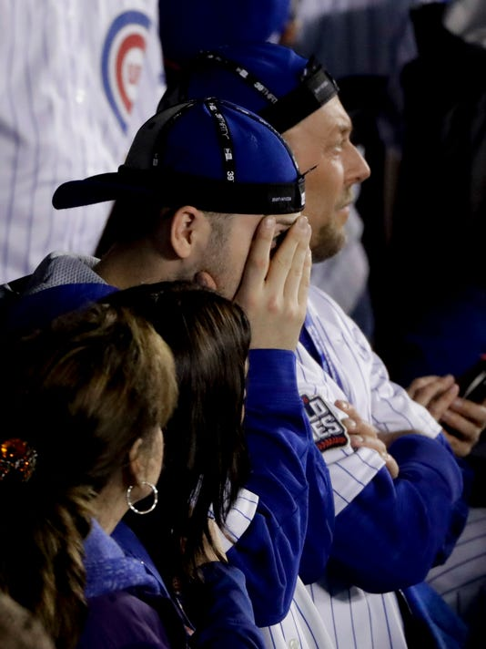 A dejected Chicago Cubs fan watches during the during the eighth inning of Game 4 of the Major League Baseball World Series against the Cleveland Indians Saturday, Oct. 29, 2016, in Chicago. (AP Photo/Charlie Riedel)