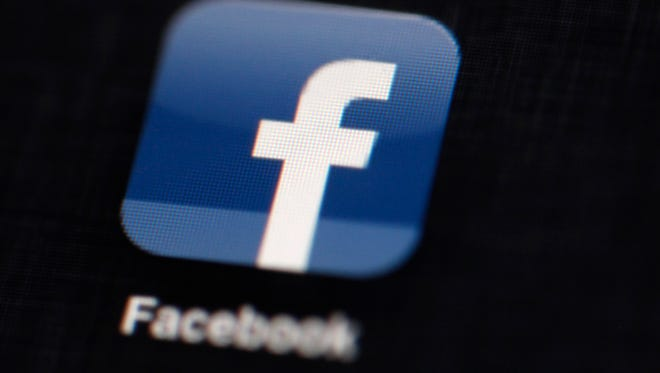 The Facebook logo is displayed on an iPad in Philadelphia.