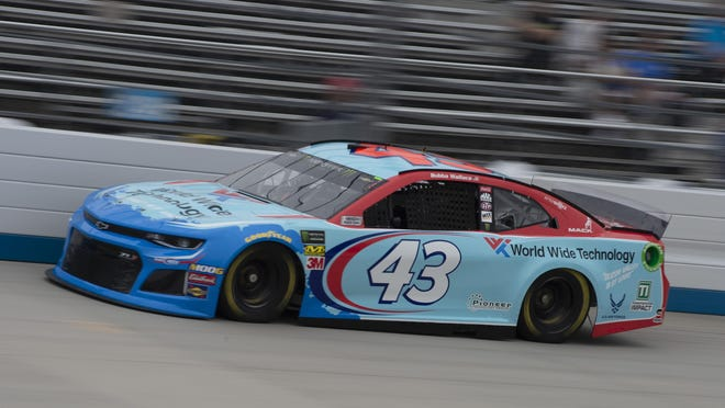 Bubba Wallace drives during practice for the NASCAR Cup Series race at Dover International Speedway in Dover, Del.