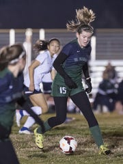 El Diamante's Carli Gordon takes the ball up field against Redwood in a West Yosemite League high school girls soccer game Friday, January 27, 2017.